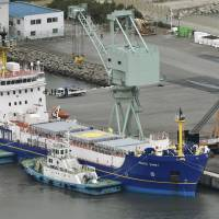 The Pacific Egret, which is expected to carry a cargo of plutonium from Japan to the U.S., is seen docked in Tokai, Ibaraki Prefecture, on Monday. | KYODO