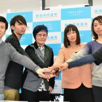 Members of citizens' groups announce Monday in Osaka the launch of a coalition that includes the Kansai branch of Students Emergency Action for Liberal Democracy (SEALDs). | KYODO