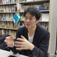 Yasuyuki Shimizu, who runs suicide prevention nonprofit organization Lifelink, discusses the revised suicide law during an interview at his Tokyo office on March 11. | TOMOHIRO OSAKI