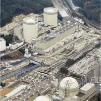 Kansai Electric Power Co.'s Takahama plant in Fukui Prefecture is seen from the air Monday. Reactor 4 is at the lower left. | KYODO
