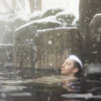The number of foreign tourists coming to Japan is increasing, and 'with that change, we hope they can fully enjoy onsen in Japan,' a Japan Tourism Agency official said. | ISTOCK