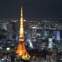 Tokyo Tower is seen last Thursday from Tokyo City View, an observation deck at the Roppongi Hills complex, in Minato Ward. | SATOKO KAWASAKI