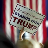 A Donald Trump supporter holds up a campaign sign for the Republican U.S. presidential candidate at a campaign rally in Columbus, Ohio, on March 1.   REUTERS