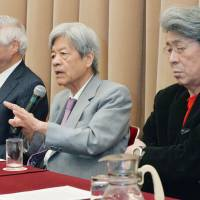 Journalist Soichiro Tahara (center) speaks Monday during a news conference held by TV newscasters in protest of recent remarks by communications minister Sanae Takaichi, who hinted that the government will suspend the operations of broadcasters that it considers politically biased. He is flanked by anchormen Shigetada Kishii (left) and Shuntaro Torigoe. | KYODO