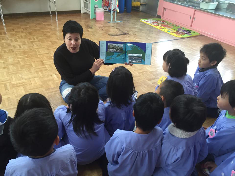 Be prepared: Amya Miller reads her new book, 'The Extraordinary Voyage of Kamome: a Tsunami Boat Comes Home,' to children in Rikuzentakata, Iwate Prefecture. | COURTESY OF AMYA MILLER