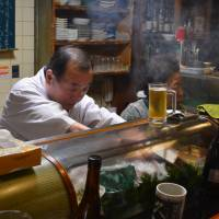 The master and the matriarch: Tiny family-run restaurant Ajikyu is located along a quiet residential street north of Kyoto's nightlife district. | J.J. O'DONOGHUE