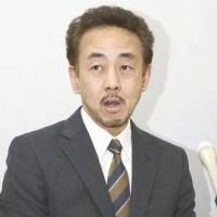 Beardy weirdy?: One of the Osaka subway drivers who is suing the city's municipal government speaks to reporters earlier this month. | KYODO
