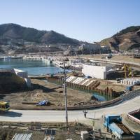 Rebirth: Reconstruction progresses in December at a bay in the Miyagi Prefecture town of Onagawa that was destroyed in the tsunami of March 11, 2011.   MICHEL HUNEAULT
