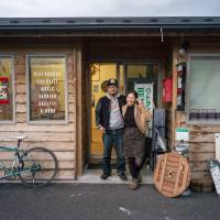 New lease: 'After the tsunami, I realized the importance of life — that we never know when something might happen to us,' says Shuhei Sakimura (left), seen here with Choko Chiba outside the temporary Sugar Shack before the bar found a permanent home in Onagawa's new town center. 'I didn't want to end up regretting how I'd lived my life, so I decided to do something that I'd always wanted to do.' | MICHEL HUNEAULT