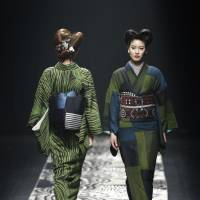 Kimono without rules: Models display creations by designer Jotaro Saito during Tokyo fashion week on March 16. | AP