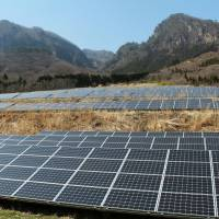 Solar panels generate energy at a farm near the city of Nakanojo, Gunma Prefecture. | KYODO