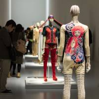Tattoo: A cotton jumpsuit from Issey Miyake's 1970/71 spring/summer collection is seen in an installation view from 'Miyake Issey Exhibition: The Work of Miyake Issey' at The National Art Center, Tokyo. | JOHN L. TRAN