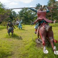A horse soldier storms through a field at The Immersion Museum — Sekigahara War Land. | STEPHEN MANSFIELD