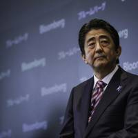Steering the ship: Prime Minister Shinzo Abe's high approval ratings may come from voters who are looking for a confident leader in troubled times. | BLOOMBERG
