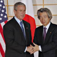 Old ways: Former U.S. President George W. Bush and Prime Minister Junichiro Koizumi meet in Kyoto in 2005. The two leaders' cooperation on the issue of the 'war on terror' led to some acts of protest in Japan. | BLOOMBERG NEWS