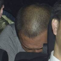 In the hot seat: Former pro baseball slugger Kazuhiro Kiyohara avoids the cameras after being arrested for alleged possession of illegal stimulants. Shukan Bunshun magazine broke this story and has scored a number of other scoops this year after editor Manabu Shintani returned to the weekly following a three-month leave of absence.   KYODO