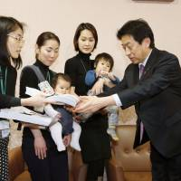 'Drop dead, Japan!' moms try to stay on message