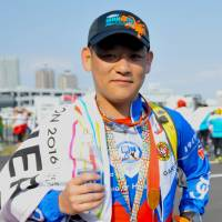 Teddy Huang, Industrial designer, 35 (Taiwanese): I did a lot of marathons and triathlon in Taiwan but this is the best — simple. The roads here are of great quality and the support along the roads is good. It is not the same in Taiwan, but I would say the second best marathon I have done is in Taipei, albeit in January when it was really cold.