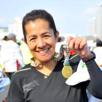 Martha Canto, Accountant, 48 (Mexican): This marathon was so beautiful. The people were so nice and polite. I love this city. Compared to Chicago or Berlin, the course was not so easy, as it has some hills, so it is a more complex marathon to run. But I have reached my target now, as this is my sixth World Marathon Major, so I am very happy.