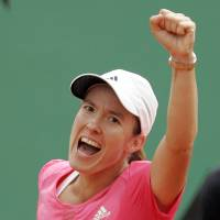 Justine Henin celebrates after her victory over Jelena Jankovic in the semifinals of the 2007 French Open. | AP