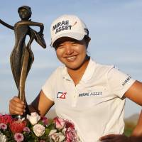 Kim Sei-young poses with her trophy after winning the JTBC Founders Cup on Sunday. | AP