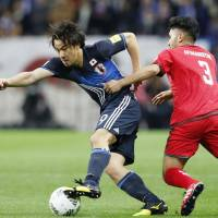 Japan's Shinji Okazaki, making his 99th international appearance, controls the ball against Afghanistan's Hassan Amin at Saitama Stadium on Thursday. Okazaki scored Japan's first goal in a 5-0 win in the World Cup qualifier. | KYODO