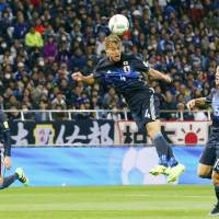 Japan's Keisuke Honda scores on a header in the 86th minute against Syria on Tuesday at Saitama Stadium. Japan defeated Syria 5-0 in the 2018 World Cup second-round qualifier. | KYODO