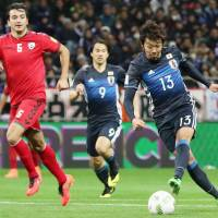 Hiroshi Kiyotake scores Japan's second goal in the 58th minute on Thursday. | KYODO