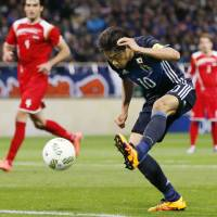 Shinji Kagawa sparks Japan with a pair of goals against Syria on Tuesday. | KYODO