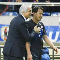 Japan manager Vahid Halilhodzic and striker Shinji Okazaki share a smile during Tuesday's match. | KYODO