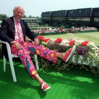 Longtime tennis commentator Bud Collins, seen here wearing his trademark colorful pants at Wimbledon in 1993, died Friday at the age of 86. | AP