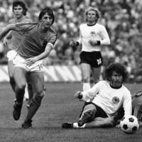 Dutch forward Johan Cruyff (left) is seen playing in the World Cup final against West Germany in a July 7, 1974, file photo. | AP