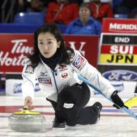 Japan claims curling silver
