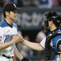 Shota Ono (right) and Shohei Otani were named the Pacific League's top battery in 2015. | KYODO