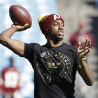 Former Washington Redskins QB Robert Griffin III, currently a free agent, met with the New York Jets on Friday, according to sources. | AP