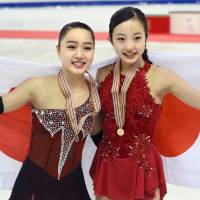 Wakaba Higuchi (left) and Marin Honda placed third and first, respectively, at the world junior championships last weekend in Debrecen, Hungary. | KYODO