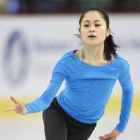 Two-time national champion Satoko Miyahara, seen here at practice on Monday, will try to win her first world title this week in Boston. | KYODO