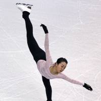 Mao Asada, seen here practicing a spiral on Monday, will attempt to win her fourth world title this week in Boston. | AP