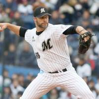 The Marines' Jason Standridge pitches during a spring training game on Sunday in Chiba. | KYODO