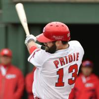 Carp outfielder Jason Pridie swings during a spring training game against the Dragons on March 13. | KYODO