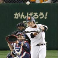 The Giants' Hisayoshi Chono slugs a solo home run in the fourth inning on Friday. | KYODO