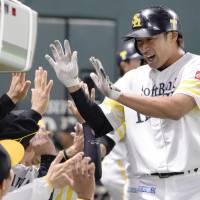 The Hawks' Yuki Yanagita celebrates after his home run off Carp pitcher Hiroki Kuroda on Sunday. | KYODO