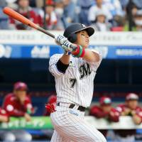 The Marines' Daichi Suzuki on Tuesday became the first Pacific League player to hit a home run this season. Suzuki finished with two homers in Chiba Lotte's 12-2 win over Tohoku Rauten at QVC Marine Field. | KYODO