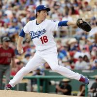 The Dodgers' Kenta Maeda pitches against the Diamondbacks on Saturday in Glendale Arizona. Maeda struck out two over two innings in his first start of the spring. | KYODO
