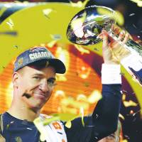 Broncos quarterback Peyton Manning lifts the Vince Lombardi Trophy after winning his second Super Bowl title on Feb. 7, 2016. | AP