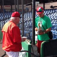 Former Philadelphia Phillies manager Charlie Manuel (left), now a senior adviser for the team and a guest instructor in spring training, gives an autograph to a fan before the Phillies play the Tampa Bay Rays in a recent game in Clearwater, Florida. | AP