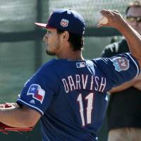Rangers right-hander Yu Darvish pitches on Wednesday in Surprise, Arizona.   KYODO