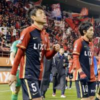 Kashima players leave the pitch after falling at home against Kofu on Wednesday. | KYODO