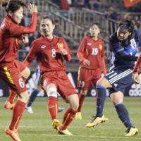 Nadeshiko Japan striker Shinobu Ono shoots to score against Vietnam on Monday night in a qualifying match for the 2016 Rio Olympics. China beat South Korea earlier in the day to end Japan's chances of qualifying. | KYODO