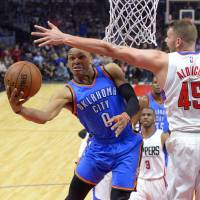 Oklahoma City's Russell Westbrook puts up a shot against Los Angeles' Cole Aldrich in the first half on Wednesday night. | AP
